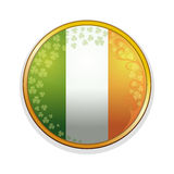 Irish flag in a golden frame decorated with leaves of clover and design elements. Clover leaves and Irish flag Stock Photos