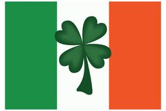 Irish Flag with Green Four Leaf Clover Royalty Free Stock Photography