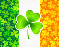 Irish flag with green and orange clovers Stock Photography