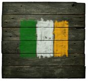 Irish flag. On old wooden planks stock photos