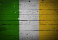 Irish flag painted on a wooden board. Irish flag painted on a white wooden board royalty free stock photos