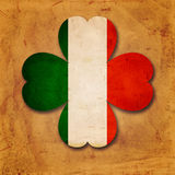 Irish flag in shamrock old paper background Stock Photo