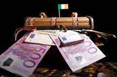 Irish flag on top of crate. Full of money stock images