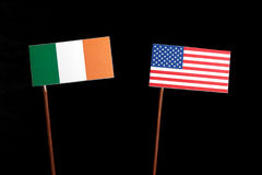 Irish flag with USA flag on black. Background stock image