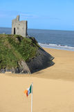Irish flag views. A view of the beach in ballybunion co kerry ireland with irish flag stock images