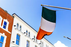 Irish flag waving from a department store`s facade in Grafton St. DUBLIN, IRELAND - 10th June, 2017: detail of the Irish flag waving from a department store`s Stock Photos