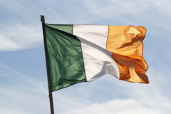 Irish Flag In The Wind. The Irish flag waving in a stiff breeze on the Aran Islands stock photos