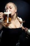 Irish girl. Pretty Irish girl drinking girl over dark background Stock Image