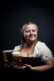 Irish girl. Posing with beer over dark background Royalty Free Stock Images