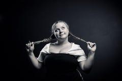 Irish girl. Pretty cheerful Irish girl posing over dark background Stock Image