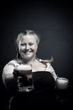 Irish girl. Pretty Irish girl with beer posing over dark background Stock Image