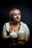 Irish girl with beer. Pretty girl with beer posing over dark background Royalty Free Stock Photos