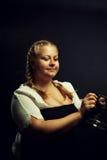Irish girl. Pretty Irish girl with mug posing over dark background Stock Image