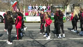 Irish Girls Dancing on Saint Patrick`s Day. Video of two groups of irish girls dancing with music at the saint patricks day parade on 3/11/18 on constitution stock video footage