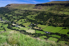 Irish Glen. Rural landscape from mountain-top looking down on the fields and farms of Glenariff in the Glens of Antrim on the east coast of Ireland royalty free stock photos