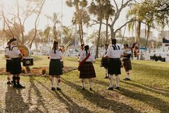 Irish Group of Bagpipe and Drummer Musicians Wearing Authentic European Kilts While Performing Traditional Celtic Music. In Scotland royalty free stock images