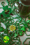 Irish: Grunge Holiday Party Background With Beads And Green Beer Stock Image