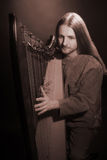 Irish harp player. Musician harpist Royalty Free Stock Photography