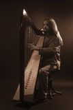 Irish harp player. Musician harpist Royalty Free Stock Images