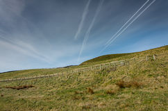 Irish Hill With Fence. This is a hill in Ireland. This is right next to the Cliffs of Moher Stock Photo