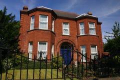 Irish house. Typical brick house in an ireland suburb Stock Photos