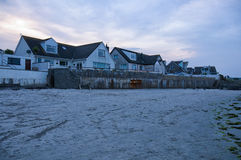 Irish houses. At the beach in northern ireland during the blue hour stock image