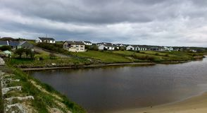Irish houses at the sea under a grey sky Stock Images