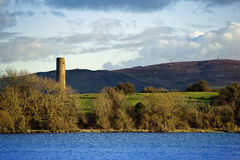 Irish lake Ree with tower Stock Photo
