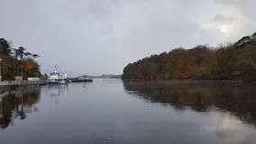 Irish lake and small harbor. A lake in the irish countryside and a small harbor royalty free stock photography