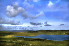 Irish Landscape. Sky, water and land in a colorful irish landscape stock image