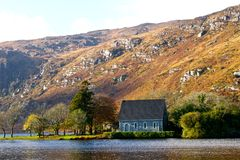 Irish Landscape. Gougane Barra, hill and monastery in Co. Cork (Ireland Stock Photo