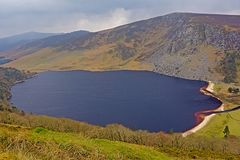 Guiness lake in wicklow mountains in the fog. Irish landscape with Guiness or loch tay lake in the fog stock image