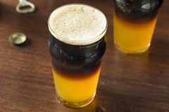 Irish Layered Black and Tan Beer. With Lager and Stought Royalty Free Stock Photos