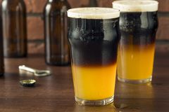 Irish Layered Black and Tan Beer. With Lager and Stought Stock Photos