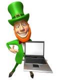 Irish leprechaun with a laptop Stock Photography