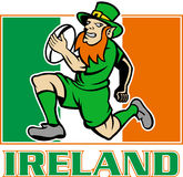 Irish leprechaun rugby player. Illustration of a cartoon  Irish leprechaun or rugby player running with ball wearing hat with flag of  Ireland in background Stock Images