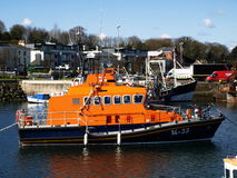 Irish lifeboat. Orange Irish lifeboat at harbor Royalty Free Stock Photography