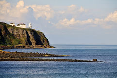 Irish lighthouse. Irish white lighthouse on Antrim Coast, Northern Ireland Stock Images