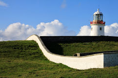 Irish Lighthouse on a green hill Stock Images