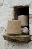Irish linen yarn on bobbins Stock Photo
