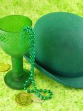 Irish Motif. Sparkly green chalice and bowler hat with gold coins Stock Photography