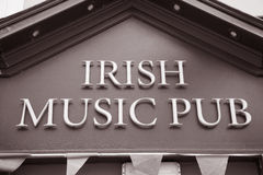 Irish Music Pub Sign. In Black and White Sepia Tone Royalty Free Stock Image
