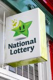 Irish National Lottery Sign. Waterford, Republic of Ireland - August 14th 2018: A sign advertising the Irish National Lottery above the entrance to a shop in the stock image