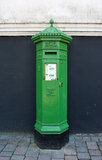 Irish Postbox. A Victorian Postbox painted green. This type of postbox is very rare and this example, photographed in New Ross, County Wexford, is thought to be Stock Image