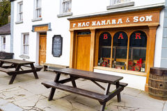 Irish pub in Bunratty. BUNRATTY, IRELAND - FEB 19: 19th century village street of Bunratty Folk Park, traditional Irish tourist attraction of Co. Clare Stock Photography