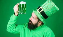 Irish pub. Drinking beer part celebration. Bar seasonal holiday menu. Dyed green traditional beer. Alcohol beverage. Lets start patricks party. Irish tradition stock photos