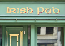 Irish pub, frontal view. Irish pub, frontal view to the old facade of an antique pub Royalty Free Stock Images