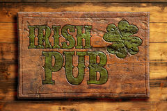 Irish pub sign. On a wooden wall Stock Photography