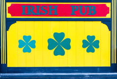 Irish Pub Sign in Yellow with Clover Royalty Free Stock Photos