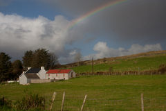 Irish Rainbow. A rainbow arches over a house in Co. Donegal, Ireland Royalty Free Stock Images